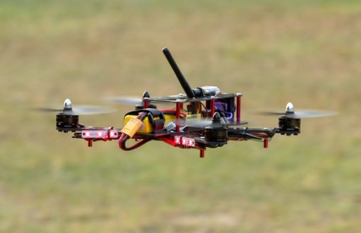 Helipal Storm Type A Racing Drone - flying side view daylight