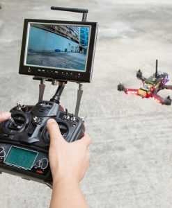 Helipal Storm Type A Racing Drone - flying with controller and tablet display