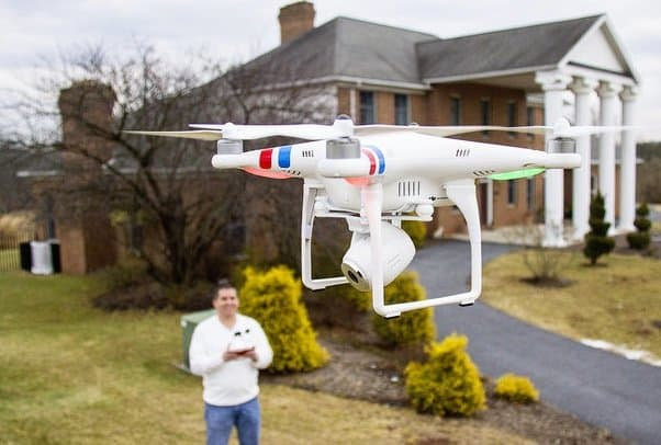 real estate agent operating a DJI phantom camera drone